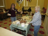 Lisa and Judy getting the cake ready
