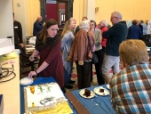 Chelsea Johnson and Sue Irvine cutting the cake.