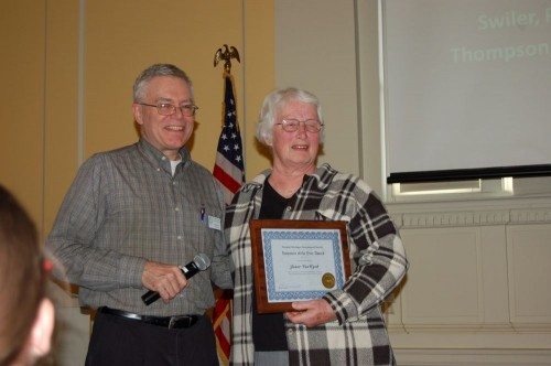 President Don Bryant presents the Volunteer of the Year Award to Jan VanWyck